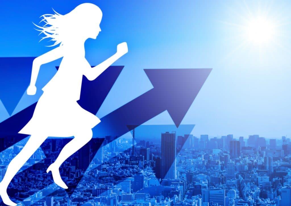 矢印、走る女性のシルエット