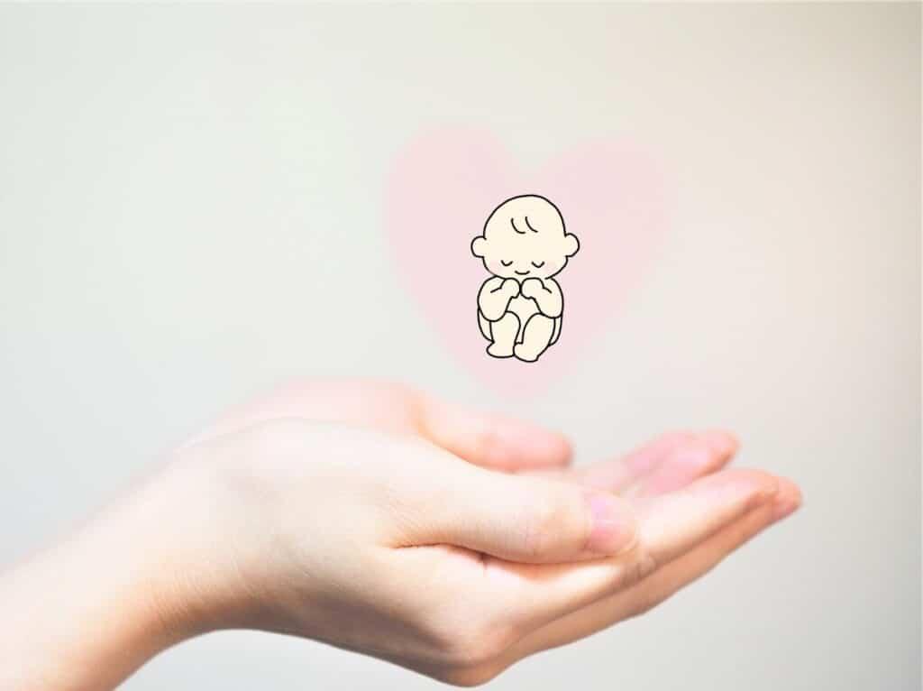 女性の手、赤ちゃんの絵