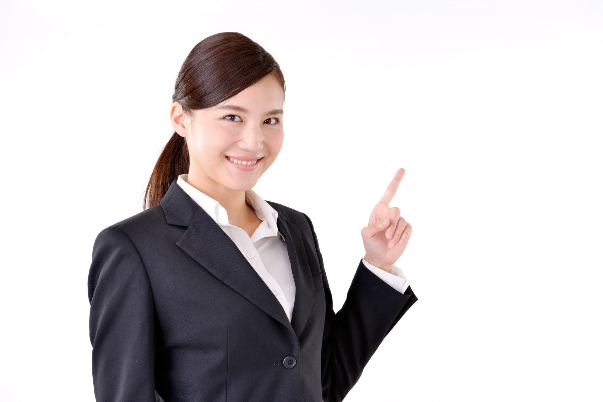 指差す女性の画像