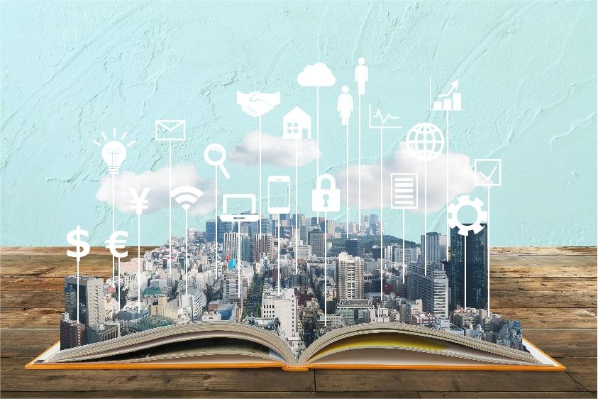 本の上の街並み、雲、アイコン